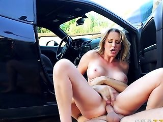 Gorgeous lady getting the facial cumshot right there by the car
