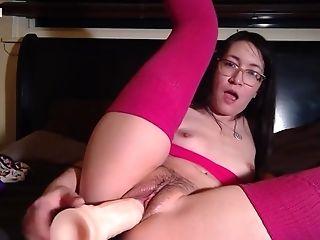 Asian Teen Tries Huge Dildo