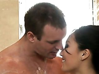 Busty Asian lady Asa Akira gives steamy deep throat to brutal American man in massage parlor