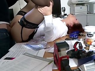 Horny secretary gets her asshole fucked in the office