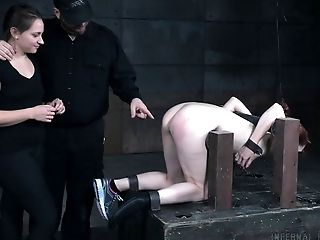 Ball gagged redhead Violet Monroe in a BDSM dungeon