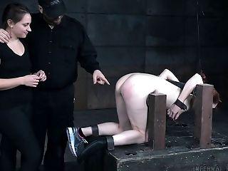 Ball gagged redhead Violet Monroe in a BDSM dungeon