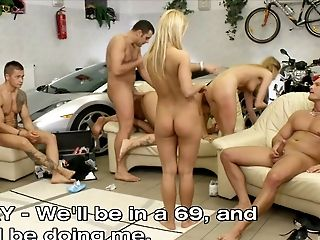 Orgy game in the garage with a group of sexy sluts