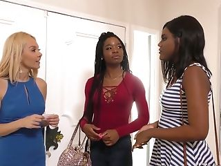 Two ebony lesbians wearing strapons fuck slender blond chick Aaliyah Love