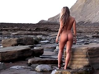 Nude babe morning walk at the ocean shore