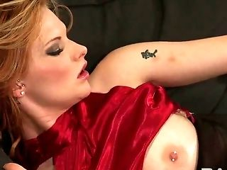 Passionate redhead Tarra White is riding this black dildo harness