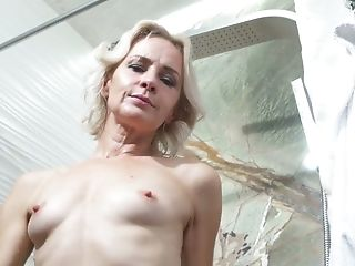 Skinny housewife Artemia takes a shower and maturates herself