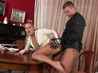Hot blooded dude fucks clothed blond bitch Barra Brass right on the table