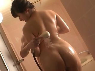 Japanese brunette MILF Haruna Hana sucks a cock in the shower